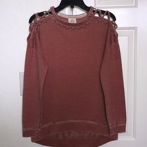 Woman's long sleeve loose fit top.